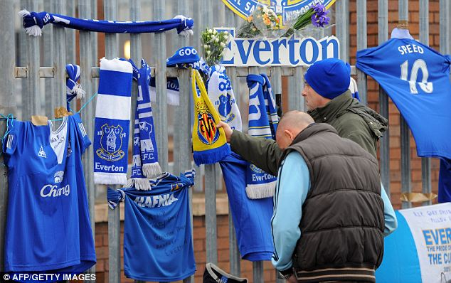 Mourning football fans leave tributes to Wales boss Gary Speed on the gates to Everton's Goodison Park stadium
