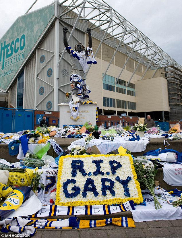 RIP Gary: The ground outside Elland Road stadium is covered with floral tributes to Gary Speed left by Leeds United fans