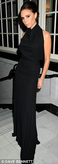 Gothic glamour: Victoria Beckham kept things simple in a long black gown at the British Fashion Awards