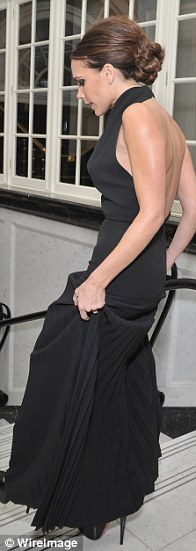 Glamorous: The gown featured a low back and showed off Victoria's slender figure