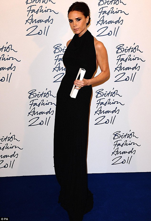 Emotional: Victoria Beckham fought back tears last night as she accepted the award for Designer Brand of the Year at the British Fashion Awards