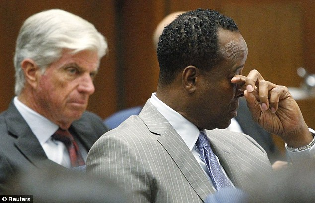 Emotional: Dr Murray wipes a tear during the opening arguments in his trial. His mother said she was 'barely standing' at the thought of her son being incarcerated