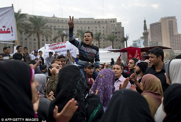 Anti-military rule protesters shout slogans during a demonstration in Tahrir Square in Cairo yesterday. Eighty people were injured in the square last night during clashes between protesters and street vendors
