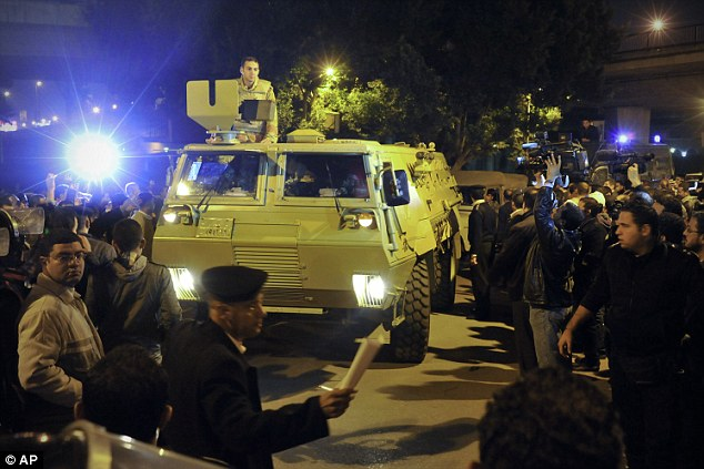 High security: An army armoured personnel carrier arrives at a vote-counting centre in Cairo after polling stations closed last night