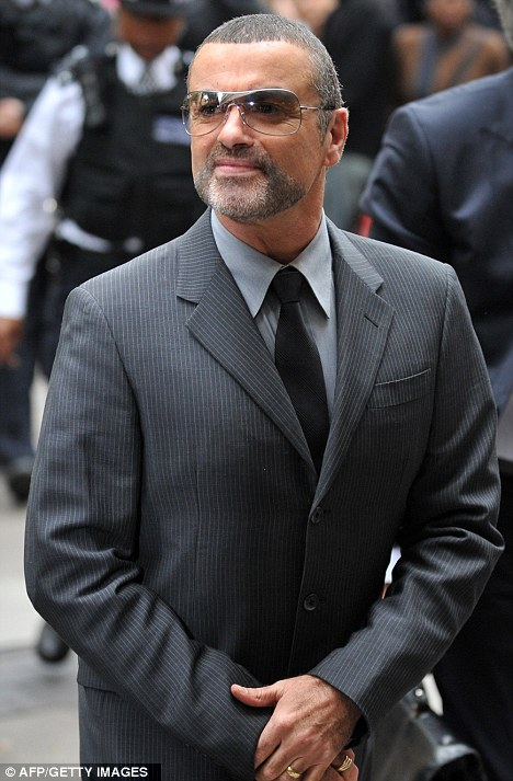 Looking up: Doctors treating George Michael say that the singer is 'improving steadily' from his bout with pneumonia