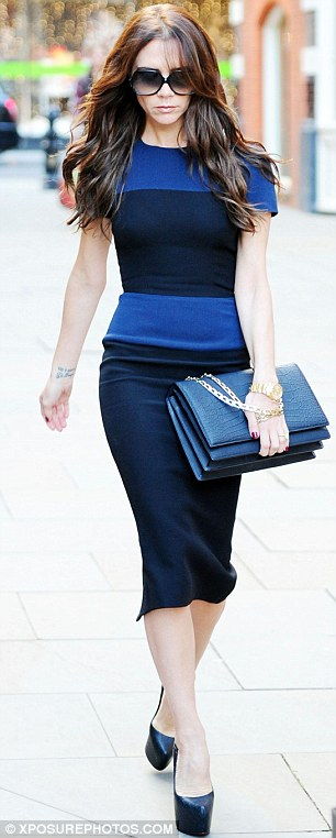 Slender: Victoria's royal and navy blue dress highlighted her slim figure