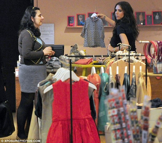 What about this one? Victoria eyes up coats, dresses and a variety of winter clothes for her four-month-old
