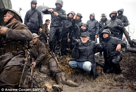 On set: Steven Spielberg, centre, sets up his next shot during filming