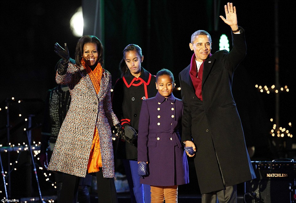 Together: President Obama and the First Family wave to the hundred-strong crowd at the Ellipse