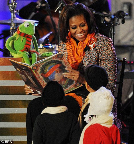 'Twas the Night Before Christmas': Mrs Obama was joined by the Jim Henson character for a reading of the Christmas classic
