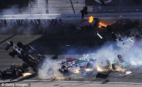 Devastating: The horrific smash that led to Wheldon's tragic death during the Las Vegas Indy 300 in October