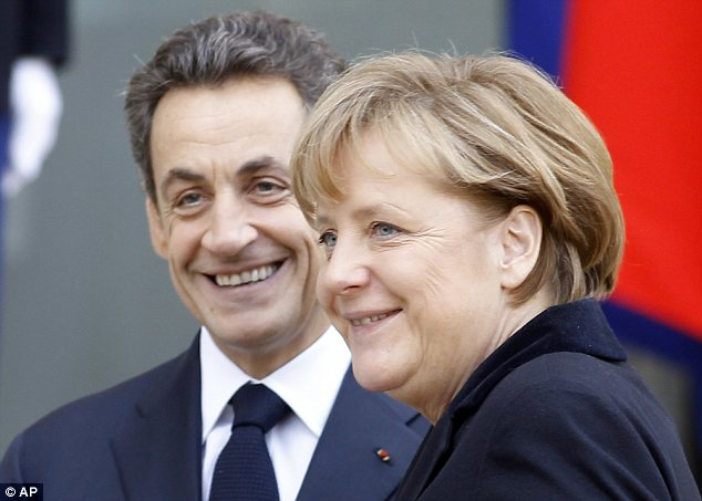 Merkozy: French President Nicolas Sarkozy (left) greets German Chancellor Angela Merkel (right) before a working lunch at the Elysee Palace in Paris today