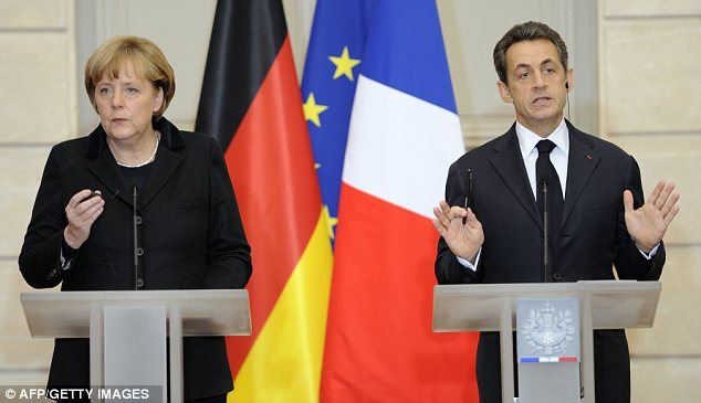 United they stand: German Chancellor Angela Merkel (left) and French President Nicolas Sarkozy (right) presented plans for a new EU treaty today
