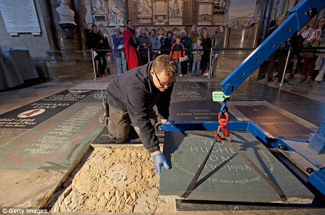 A stonemason lays the memorial stone in the Abbey's Poets' Corner. There had been a campaign to celebrate Hughes in the abbey, as poets laureate are not automatically recognised