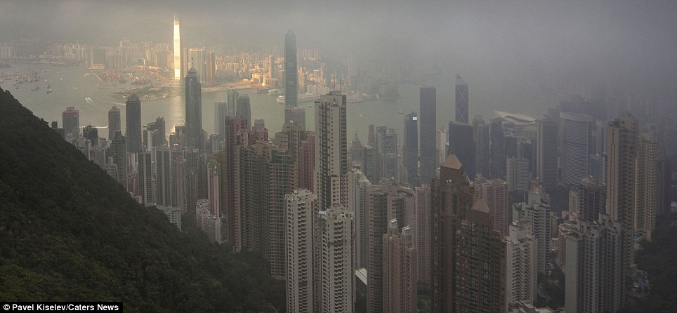Brought to life: Pavel Kiselev took these stunning shots from Victoria Peak, the highest mountain on Hong Kong Island, while on holiday there
