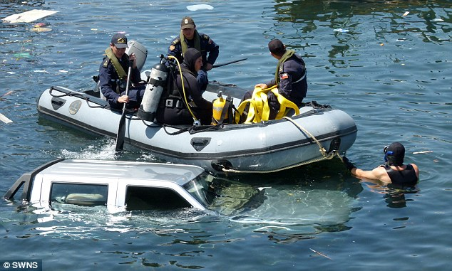 That's a fail! A woman taking her driving test in Chile crashed into the Pacific Ocean after she misjudged a bend