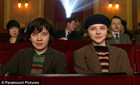 Cinema lovers: Chloe and Asa in a scene from Hugo, which is in cinemas now across the UK