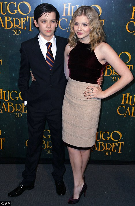 Are they really the same age? Chloe poses with co-star Asa Butterfield who is only two months younger than her but looked like her little brother last night