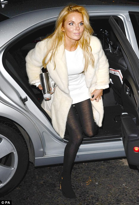 Chauffeur driven: Geri steps out the car with a thermos flask after getting a lift to the venue
