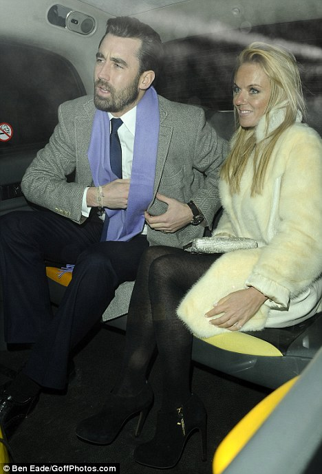 Living the high life: Geri and her friend cruised away together in a taxi