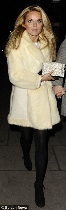 Windswept: Geri looked festive in a snowy coat,