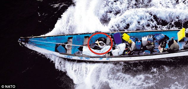 Frenchwoman Evelyne Colombo being held hostage in a pirate skiff on September 10, prior to her rescue