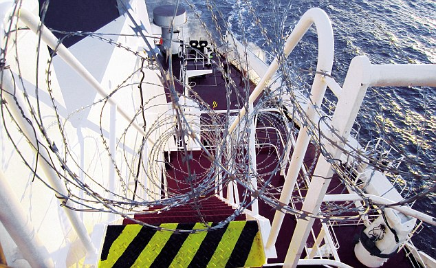 A merchant ship 'hardened' with loops of razor wire for its journey from Somalia to Mombasa, Kenya