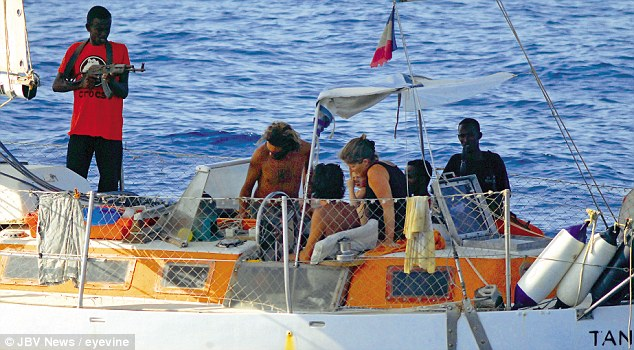 The French yacht Tanit being held by pirates in 2009 - one of the hostages was killed during the rescue operation