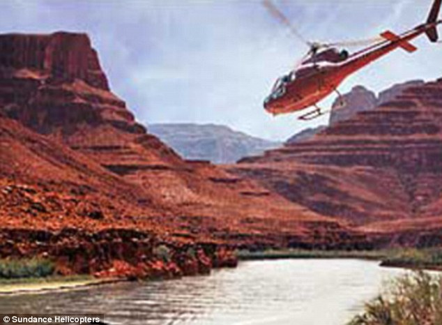 Explosion:  A pilot and four passengers were killed after their helicopter went down during a tour of the River Mountains, Nevada