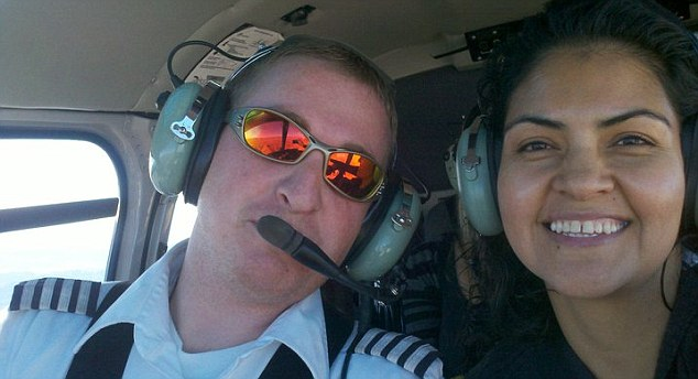 Happy couple: Pilot Landon Nield and his new wife Gabriela Orozco take a helicopter trip