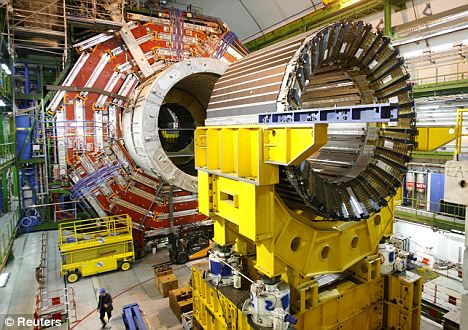 Heavy duty: The 13,000-ton CMS detector is one of two being used by CERN to find the 'God particle'
