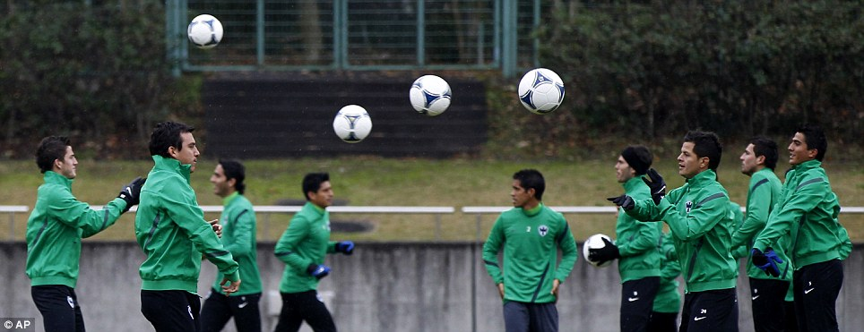 CF Monterrey players are put through their paces as the Mexican club warm up for the Club World Cup in Japan