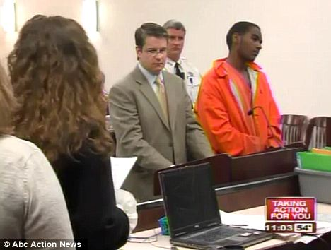 Speaking out: Ms Damon, with her back facing the viewer, reads out her statement to her attacker Javon Cooper, who kept looking away throughout