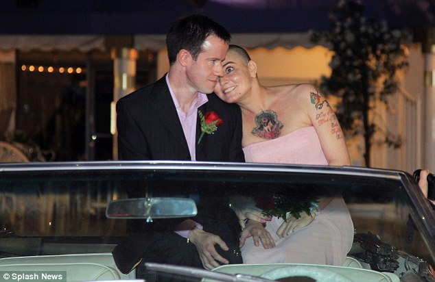 We did it! The newly married couple snuggled up on a pink Cadillac