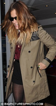 On her way out: Caroline Flack is seen clutching an overnight bag yesterday afternoon
