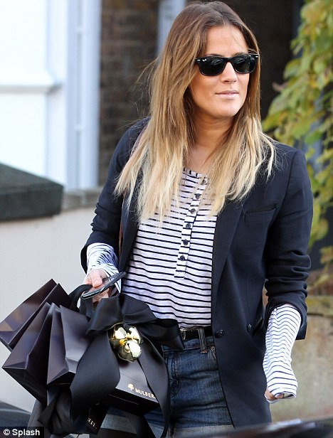 Christmas gifts Caroline? The Xtra Factor presenter holds Mulberry gift bags with Christmas ribbons on