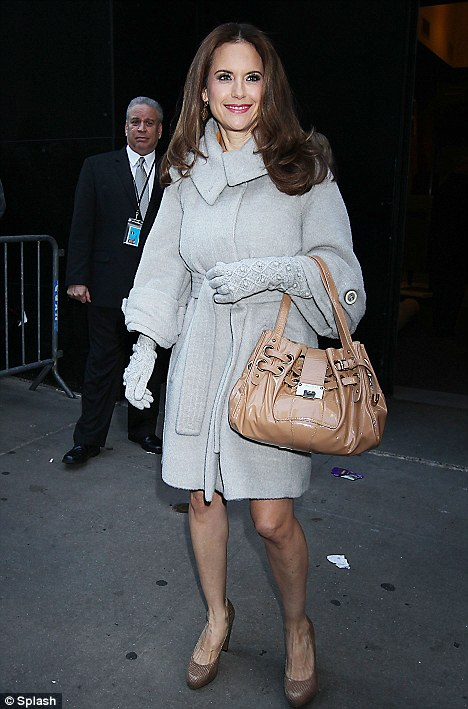 Covering up: The 49-year-old actress donned a grey coat to keep herself warm from the cold NYC morning
