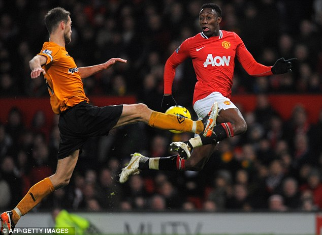 Battle: Danny Welbeck rights for the ball with Wolves defender Roger Johnson