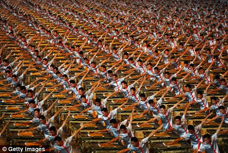 Last time around: 2,008 drummers from the People's Liberation Army performing at the opening ceremony of the Beijing Olympics