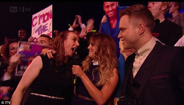 Support at home: Marcus's fans were out in force, chatting to Olly Murs and Caroline Flack