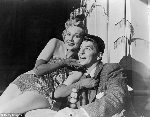 Mr President: Virginia Mayo, dressed as a burlesque dancer, sits on the lap of future president Ronald Reagan while shooting the film She's Working Her Way Through College in 1952