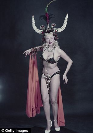 Showgirls: Tempest Storm was particularly brazen in the shot on the left, showing her nipple and wearing a sheer dressing gown, while the unidentified dancer on the right wore a horned headdress and bottoms