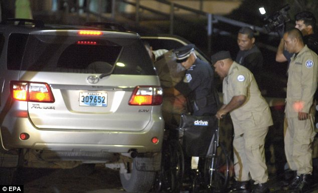 Helping hand: Noriega was helped out of a car after arriving at the Renacer prison