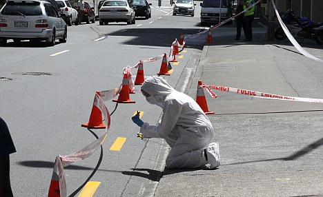 Crime scene: A forensics officer in Boulcott Street, Wellington, where Mr Cottrell was attacked