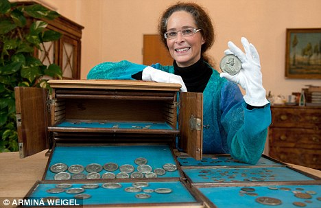 Rare find: German library janitor Tanja Hols poses with her valuable discovery, which she found on a fourth floor archive