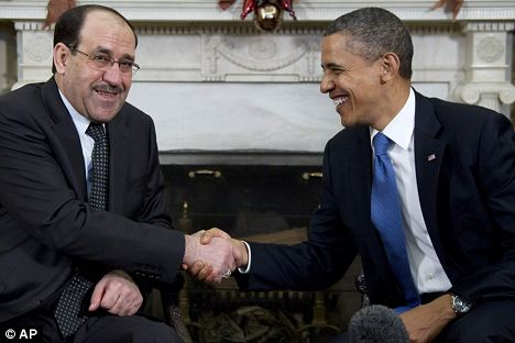 On with the show: President Barack Obama meets with Iraq's Prime Minister Nouri al-Maliki in the White House in Washington