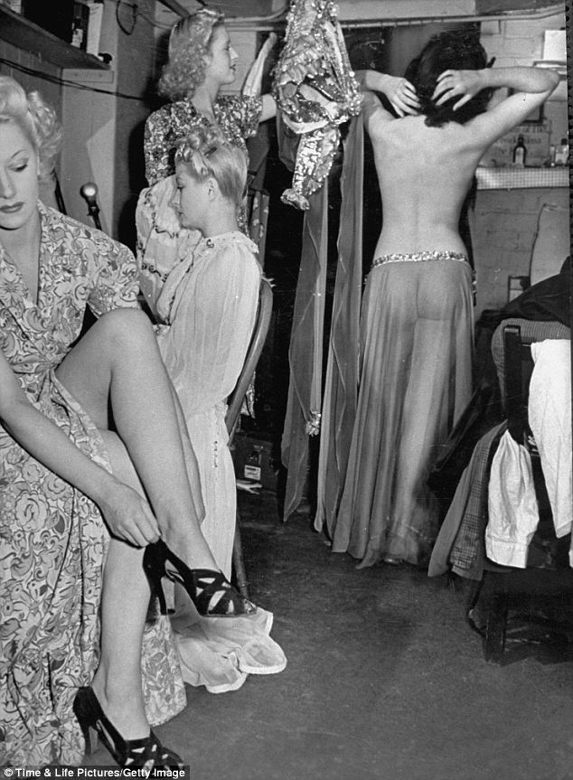 Working girls: This picture shows the women getting ready to go on stage at the Windmill Theatre in 1942