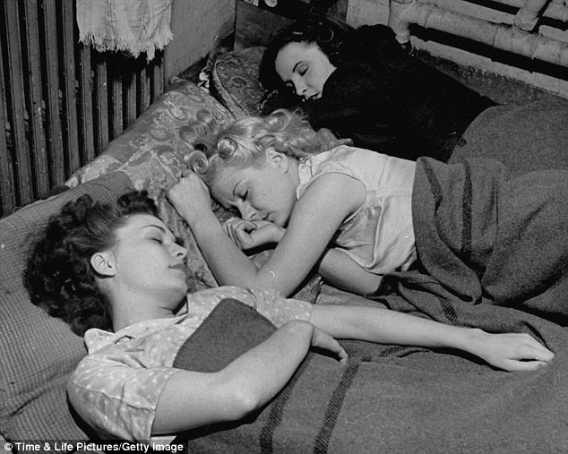 Hard days work: Three British burlesque dancers sleep in an underground bunker during the Blitz after performing at the Windmill Theatre in March 1942