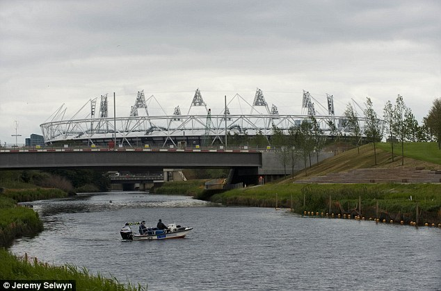 Lurking: The mysterious beast could venture towards the Olympic Park site after reports of a large predator in the nearby River Lea
