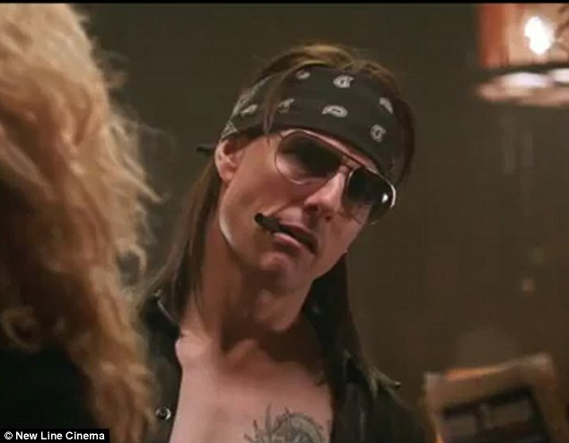 Sign of the times: Tom Cruise's sleazy rocker character Stacee Jaxx signs a fan's breast in the new trailer for upcoming musical Rock of Ages
